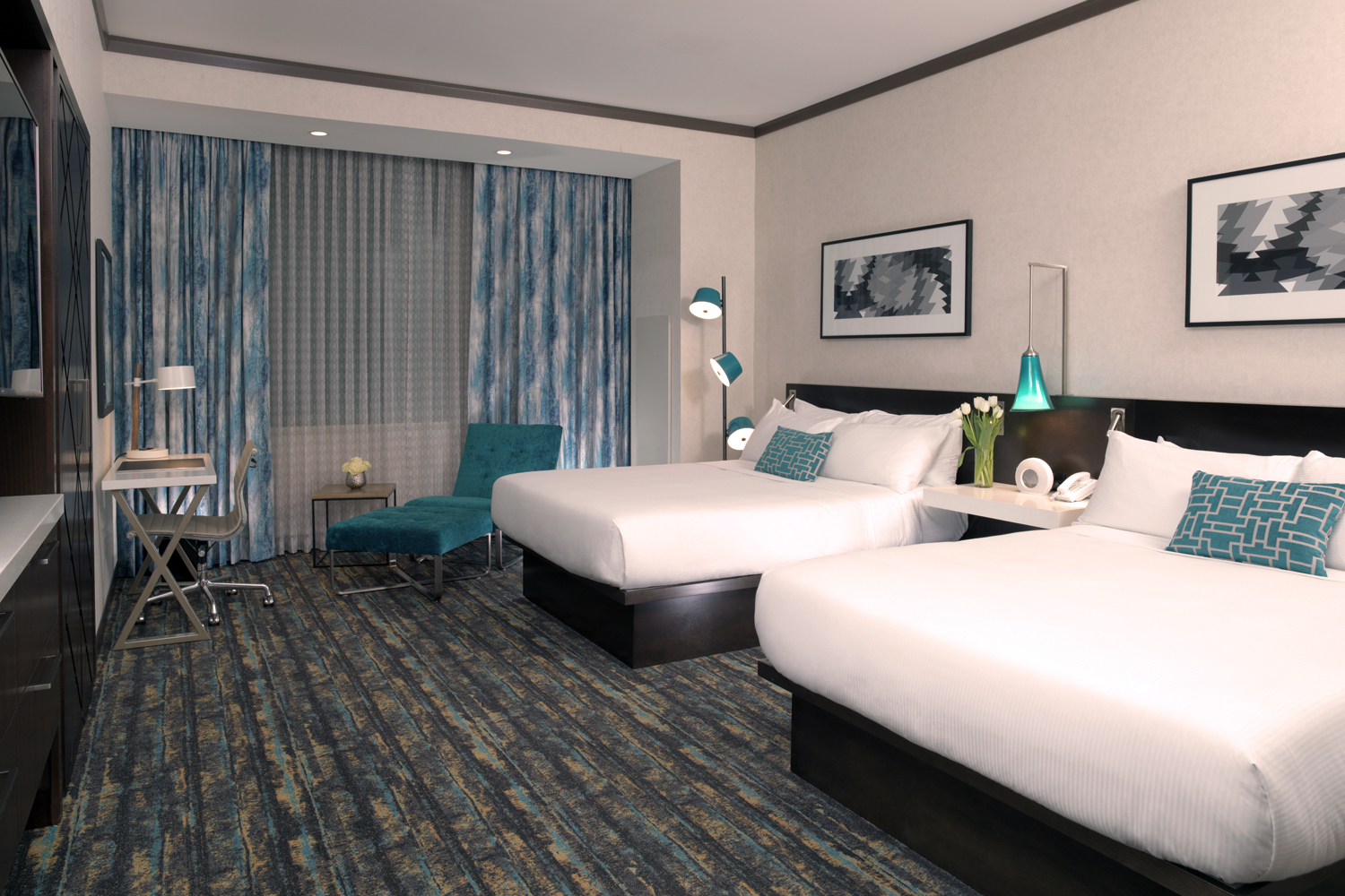 Need more than one bed?  Our Deluxe Two-Queen Room is the perfect choice.